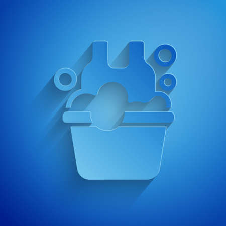 Paper cut Plastic basin with soap suds icon isolated on blue background. Bowl with water. Washing clothes, cleaning equipment. Paper art style. Vector