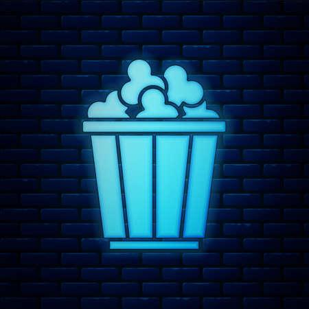 Glowing neon Popcorn in cardboard box icon isolated on brick wall background. Popcorn bucket box. Vector
