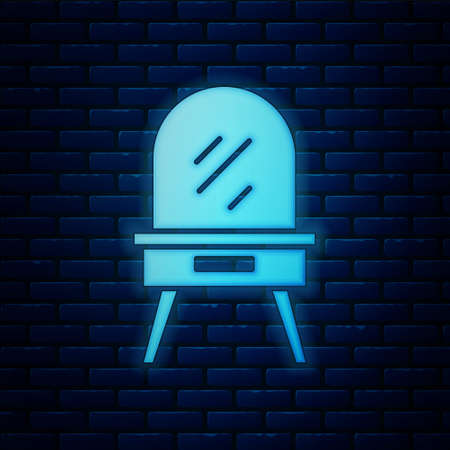 Glowing neon Dressing table icon isolated on brick wall background. Vector