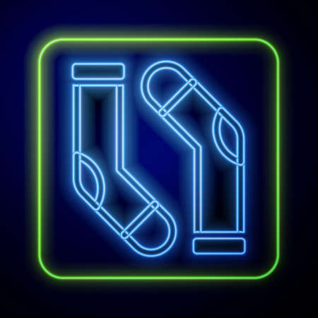 Glowing neon Socks icon isolated on blue background. Vector