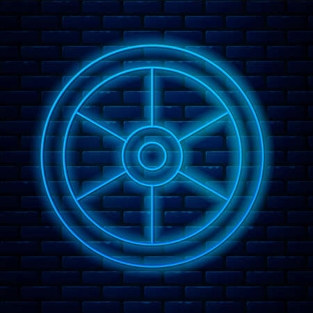 Glowing neon line Bicycle wheel icon isolated on brick wall background. Bike race. Extreme sport. Sport equipment. Vector