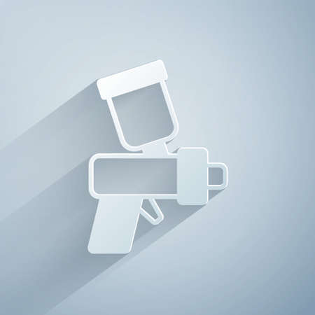 Paper cut Paint spray gun icon isolated on grey background. Paper art style. Vector