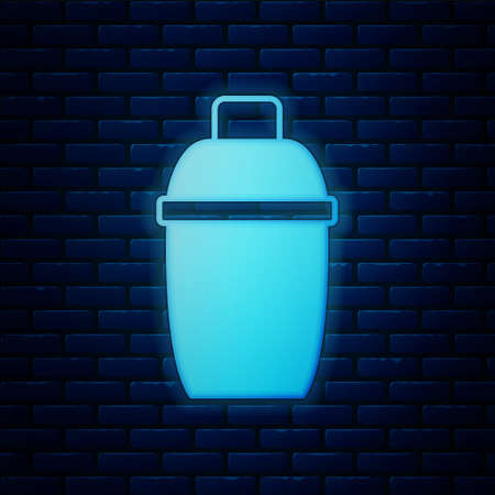 Glowing neon Cocktail shaker icon isolated on brick wall background. Vector