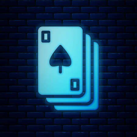 Glowing neon Playing cards icon isolated on brick wall background. Casino gambling. Vector