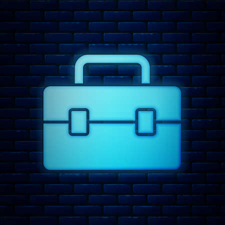 Glowing neon Toolbox icon isolated on brick wall background. Tool box sign. Vector