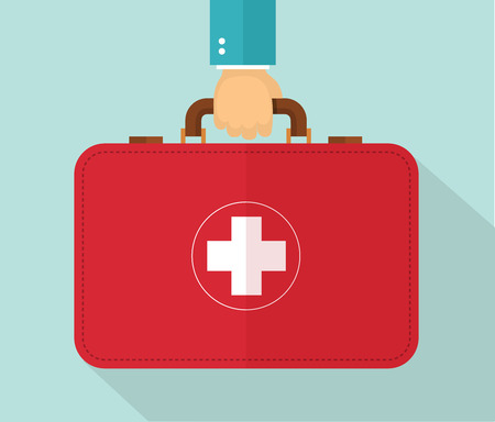 first aid box: Hand holding healthcare briefcase.