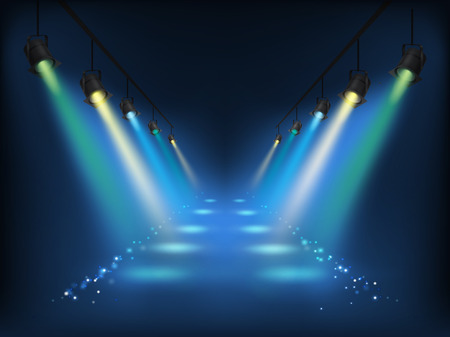 Set of vector colored scenic spotlights on a dark background