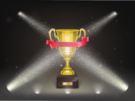 Vector 3d realistic cup on pedestal with red ribbon on stage. Golden trophy on scene in projector s lights and confetti. Shiny gold metal goblet. Reward, prize isolated on black background.