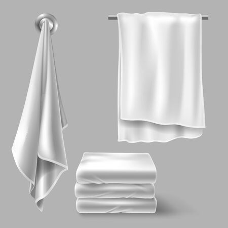White cloth towels on hangers and folded in stack. Vector realistic mockup of fabric towels for bathroom, spa hotel, beach or kitchen isolated on gray background