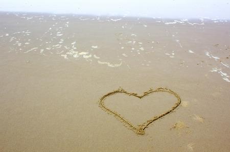 heart shape drawn on beach Stock Photo