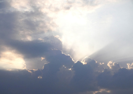 stormy clouds: Sunrays Stormy Clouds Stock Photo