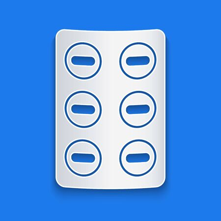 Paper cut Pills in blister pack icon isolated on blue background. Medical drug package for tablet, vitamin, antibiotic, aspirin. Paper art style. Vector Illustration
