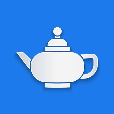 Paper cut Traditional Chinese tea ceremony icon isolated on blue background. Teapot with cup. Paper art style. Vector Illustration