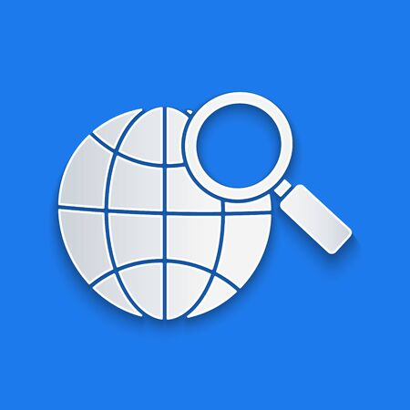 Paper cut Magnifying glass with globe icon isolated on blue background. Analyzing the world. Global search sign. Paper art style. Vector Illustration