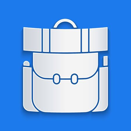 Paper cut Hiking backpack icon isolated on blue background. Camping and mountain exploring backpack. Paper art style. Vector Illustration