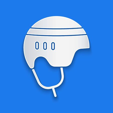 Paper cut Hockey helmet icon isolated on blue background. Paper art style. Vector Illustration