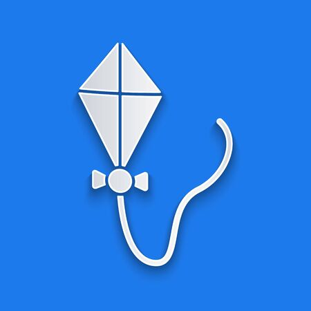Paper cut Kite icon isolated on blue background. Paper art style. Vector Illustration