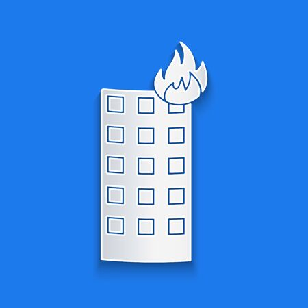 Paper cut Fire in burning building on city street icon isolated on blue background. Paper art style. Vector Illustration