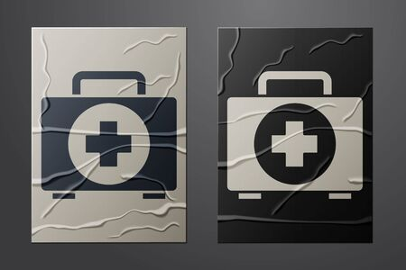 White First aid kit icon isolated on crumpled paper background. Medical box with cross. Medical equipment for emergency. Healthcare concept. Paper art style. Vector Illustration