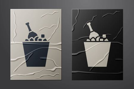 White Bottle of champagne in an ice bucket icon isolated on crumpled paper background. Paper art style. Vector Illustration