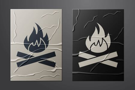 White Campfire icon isolated on crumpled paper background. Burning bonfire with wood. Paper art style. Vector Illustration