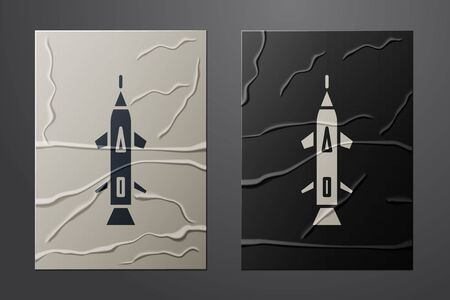 White Rocket icon isolated on crumpled paper background. Paper art style. Vector Illustration