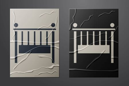White Baby crib cradle bed icon isolated on crumpled paper background. Paper art style. Vector Illustration
