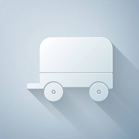 Paper cut Wild west covered wagon icon isolated on grey background. Paper art style. Vector Illustration