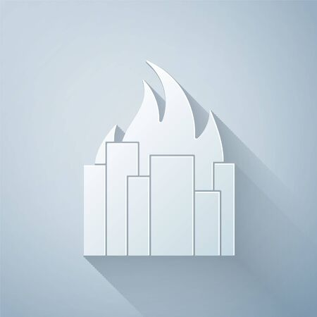 Paper cut Fire in burning buildings on city street icon isolated on grey background. Destroyed city on fire. Paper art style. Vector Illustration