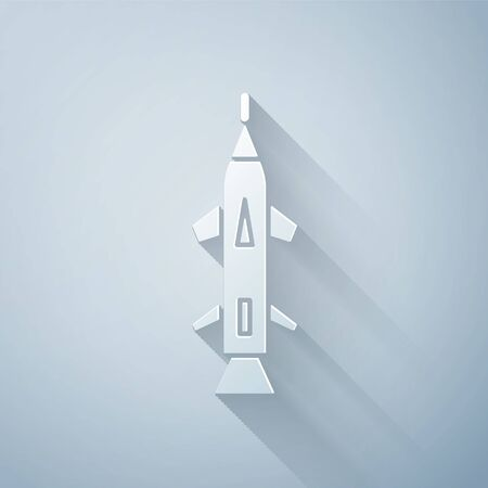 Paper cut Rocket icon isolated on grey background. Paper art style. Vector Illustration Ilustração