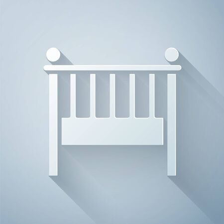 Paper cut Baby crib cradle bed icon isolated on grey background. Paper art style. Vector Illustration Illusztráció