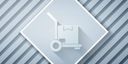 Paper cut Hand truck and boxes icon isolated on grey background. Dolly symbol. Paper art style. Vector Illustration Ilustração