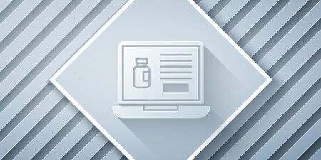 Paper cut Buying drugs online on laptop icon isolated on grey background. Online buying symbol. Paper art style. Vector Illustration Reklamní fotografie - 140629832