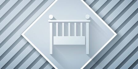 Paper cut Baby crib cradle bed icon isolated on grey background. Paper art style. Vector Illustration Ilustrace