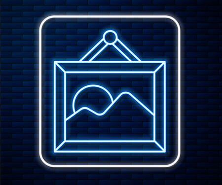 Glowing neon line Picture landscape icon isolated on brick wall background. Vector Illustration