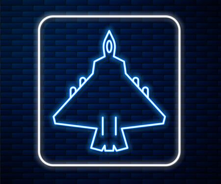 Glowing neon line Jet fighter icon isolated on brick wall background. Military aircraft. Vector Illustration