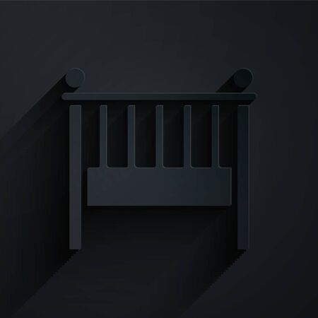 Paper cut Baby crib cradle bed icon isolated on black background. Paper art style. Vector Illustration
