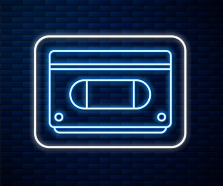 Glowing neon line VHS video cassette tape icon isolated on brick wall background. Vector Illustration
