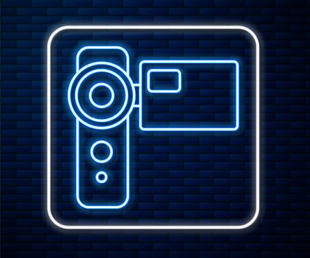 Glowing neon line Cinema camera icon isolated on brick wall background. Video camera. Movie sign. Film projector. Vector Illustration