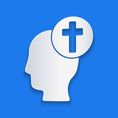 Paper cut Human head with christian cross icon isolated on blue background. Paper art style. Vector Illustration