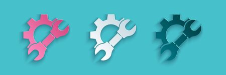 Paper cut Wrench spanner and gear icon isolated on blue background. Adjusting, service, setting, maintenance, repair, fixing. Paper art style. Vector Illustration