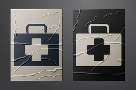 White First aid kit icon isolated on crumpled paper background. Medical box with cross. Medical equipment for emergency. Healthcare concept. Paper art style. Vector