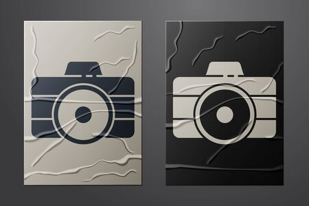White Photo camera icon isolated on crumpled paper background. Foto camera icon. Paper art style. Vector