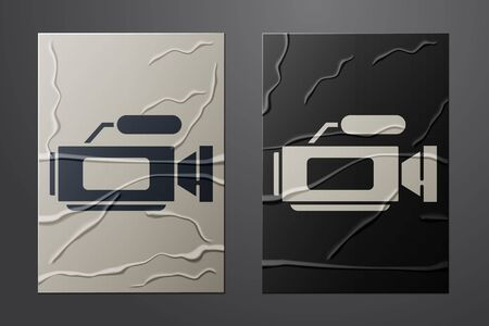 White Cinema camera icon isolated on crumpled paper background. Video camera. Movie sign. Film projector. Paper art style. Vector