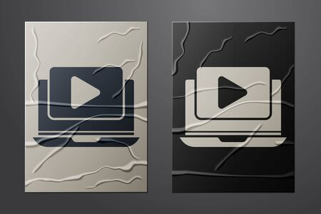 White Online play video icon isolated on crumpled paper background. Laptop and film strip with play sign. Paper art style. Vector
