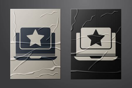 White Laptop with star icon isolated on crumpled paper background. Favorite, best rating, award symbol. Paper art style. Vector