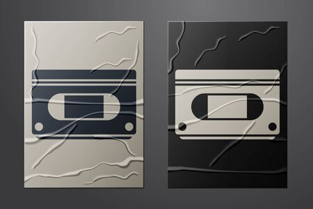 White VHS video cassette tape icon isolated on crumpled paper background. Paper art style. Vector Vettoriali