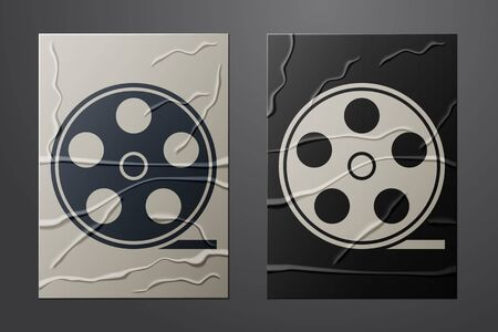 White Film reel icon isolated on crumpled paper background. Paper art style. Vector
