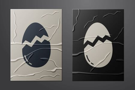 White Broken egg icon isolated on crumpled paper background. Happy Easter. Paper art style. Vector Vettoriali