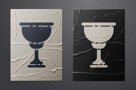 White Christian chalice icon isolated on crumpled paper background. Christianity icon. Happy Easter. Paper art style. Vector